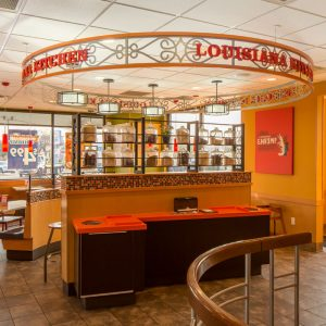 Restaurant seating area of Popeyes and GoCo combination