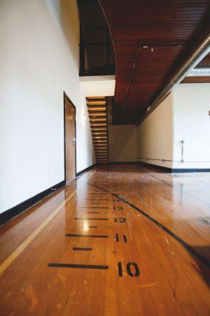 Alumni Lofts common residential area with gymnasium marking on floor