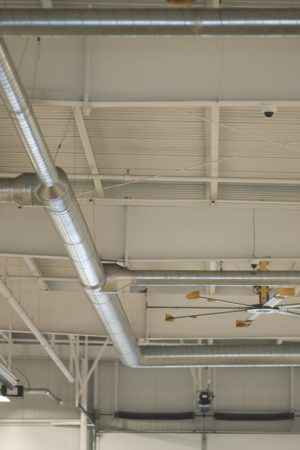 Overhead ventilation tubes in the garage at Piles Chevrolet